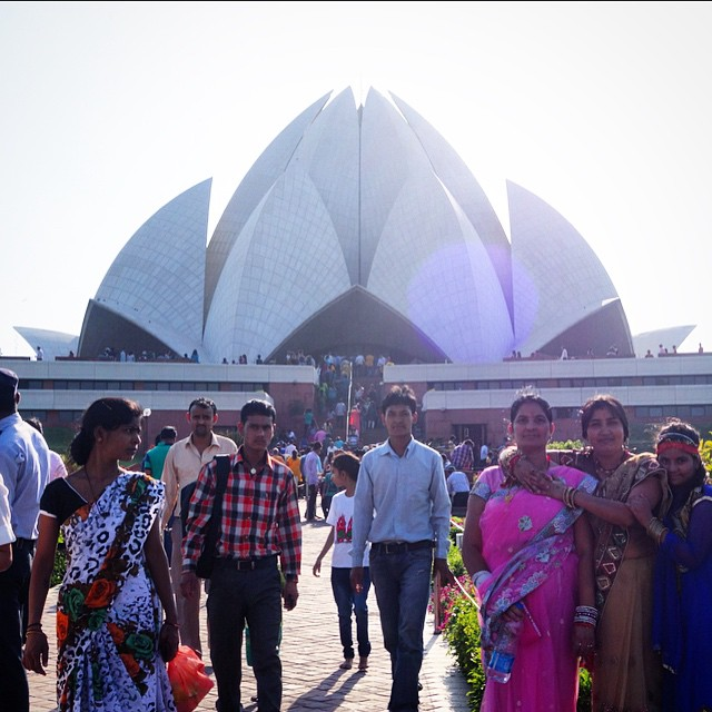 "The Lotus Temple, Bahai Temple.  It was so beautiful here. It felt so spiritual.  A temple for all religions. This group of girls on the right were about the 7th group of people to ask to take a picture with me, so I asked if I could take a photo of them :) At least people started to ask instead of sneakily trying to take pictures of me when I wasn't looking.  I thought I was paranoid, but they really were! I couldn't get a straight answer as to why really, but I got ""because your personality is greater than mine"", ""because you are our guest"", and this last group of girls came up smiling and giggling and started saying ""you're so beautiful"". Not sure which was the truth or what, but apparently my Indian friends back home told me it is because they probably thought I was a celebrity and that people in India are not used to seeing people with my skin tone, or that wear lipstick, or shorts and skirts for that matter. My friend/coworker, Ramya, said when she was a kid in India she was always in awe when she would see Americans."
