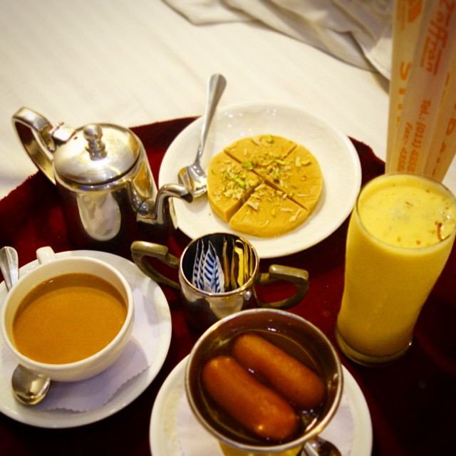 Dessert and masala tea in the room at Hotel Palace Heights in New Delhi.