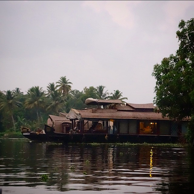 This is a view of our houseboat from the canoe ride we took into the sunset. The front left is where we had our meals and hung out, above that on the top of the boat is a covered deck we could relax and lay out on, and on the right you can see our bedroom with the shade drawn. This was such a cool experience. Alleppey Backwaters, Kerala, South India. Lakes & Lagoons Devas Indulge. Thankfully I had sea bands on me :) because I needed them!