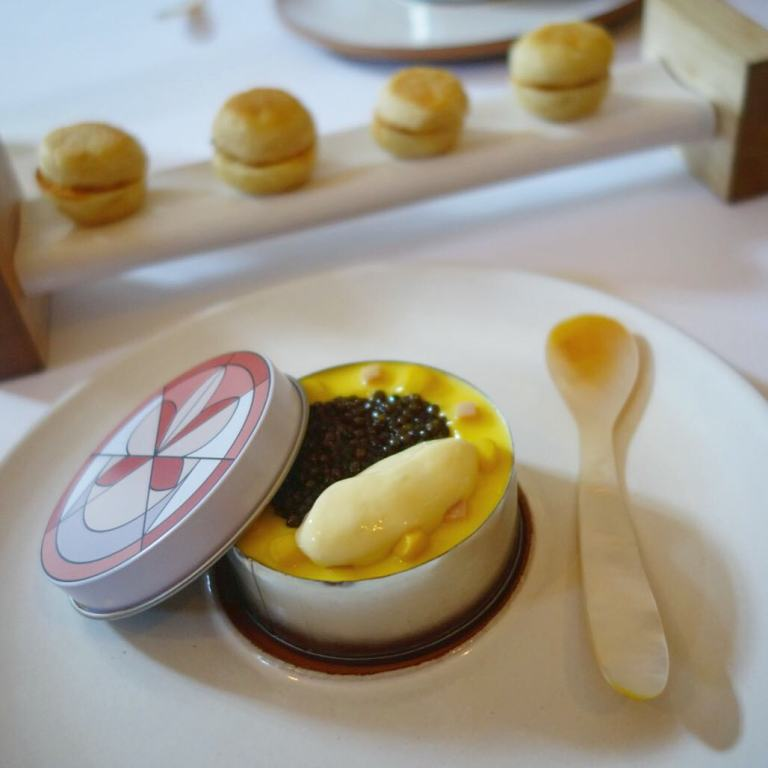 Eleven Madison Park - Birthday dinner - Caviar Eggs Benedict - bacon gelée, poached quail egg, corn & ham, topped with corn liquor reduction/jelly and caviar served with homemade english muffins