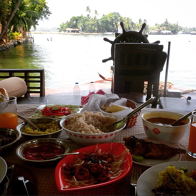 We were lucky enough to stay on a luxury houseboat in Kerala. What an experience.  We had a crew of 3 guys who took us on an overnight trip through the backwaters of Kerala and cooked all of our meals for us. This is shrimp, tomato chutney and fresh fried fish. It was so fresh and flavorful. So delicious. Lakes and Lagoons really took care of us.  The bed on our private boat was very comfortable.  Just wish the AC worked a little better haha.  It also took 3 hours to fill the Jacuzzi lol. We stayed on the Devas Induldge.  <3 so nice.  Alleppey, India.