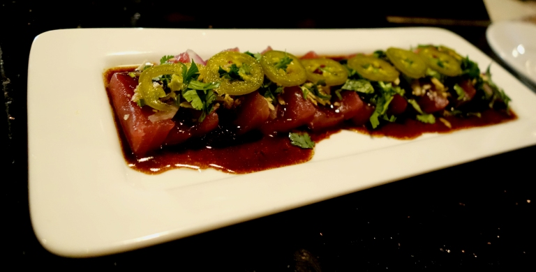 Desnuda NYC – Tiradito de Atun – Yellow fin tuna in a savory shishito -yuzu-truffle glaze, pickled jalapeños, red onion and potato chip crunch