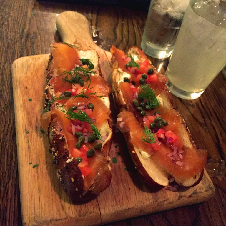 Tanner Smiths – Midtown NYC – Smoked Salmon Sammy – House smoked Atlantic salmon, dill cream cheese, on a warm everything pretzel with capers tomato and red onion FTW