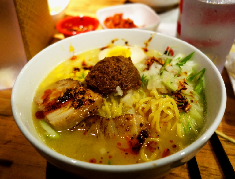 Totto Ramen - Midtown 52nd Street NYC - Extra spicy miso paitan topped with pork char siu and corn added for the win (comes with bean sprouts but I am not a fan of them in soup so I always ask for no bean sprouts!) This is topped with the finest Koji Miso and ground pork. Nomnom