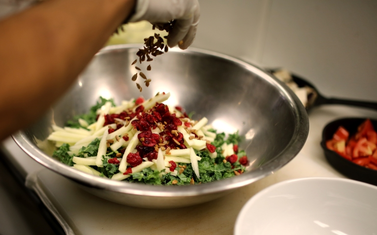 My favorite kale salad being prepared right in front of me. Kale, julienned green apple that's been soaked in lemon and water, craisins, and sunflower seeds which have been roasted at 325 degrees for 28 minutes, stirring half way through.
