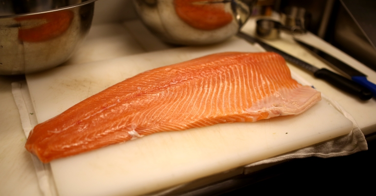 Norwegian salmon ready to be filleted by Chef Juan Aranda. Alway fresh, never frozen.