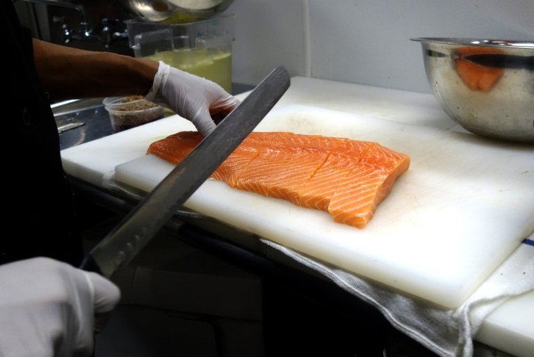 Chef Juan masterfully filleting the salmon