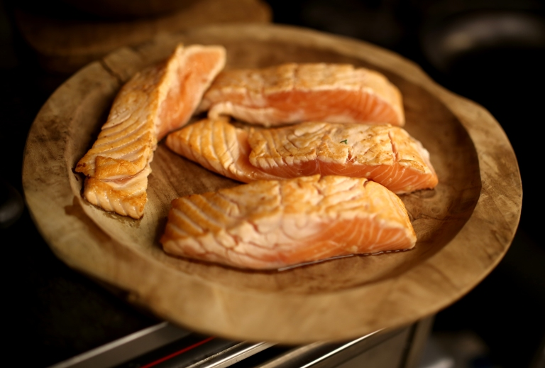 The split salmon is cooked in a very hot pan on each side for only 30-45 seconds just to get a nice sear on the outside and seal the flavor in.